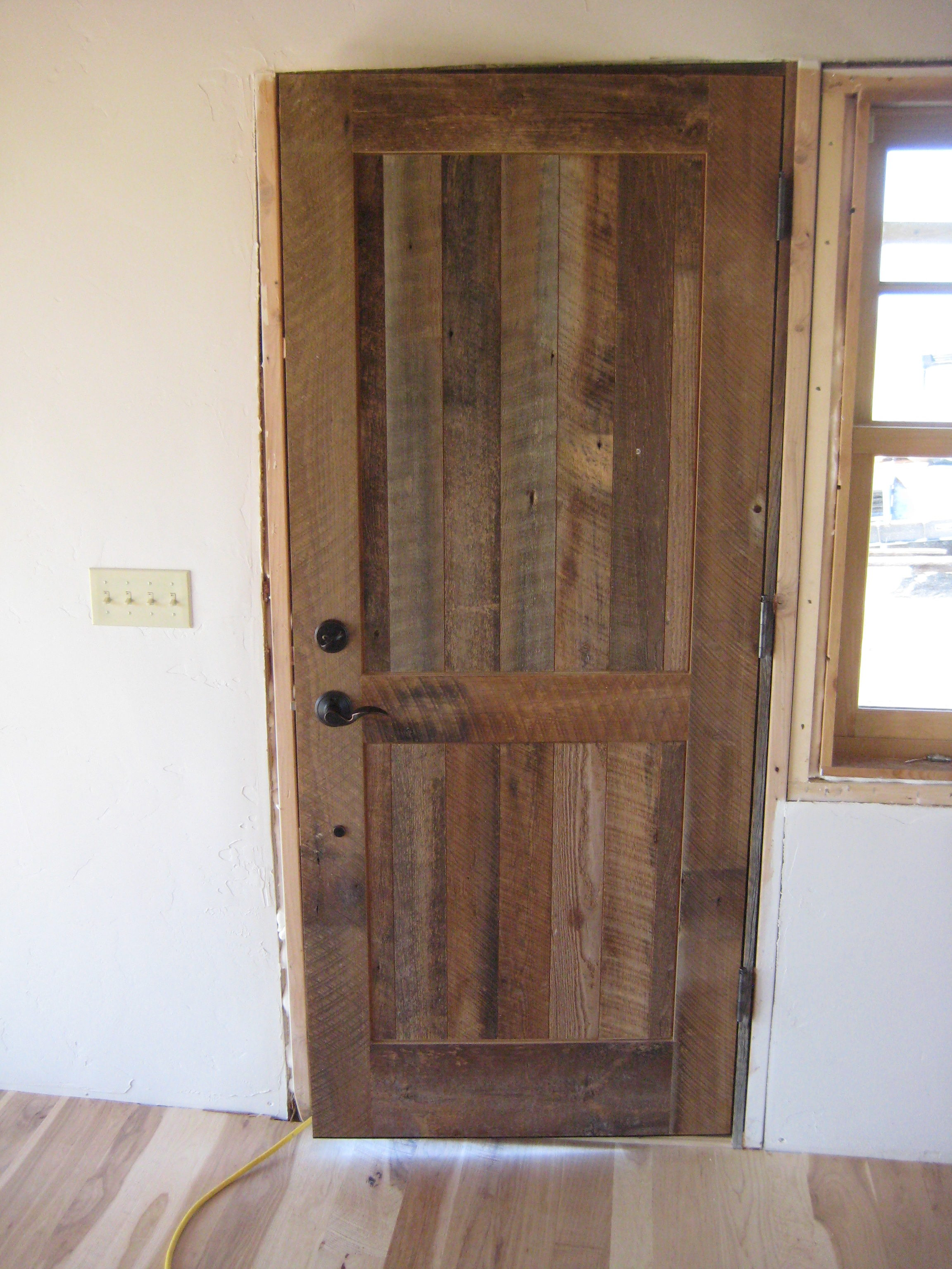 New doors were made were needed from reclaimed barn wood