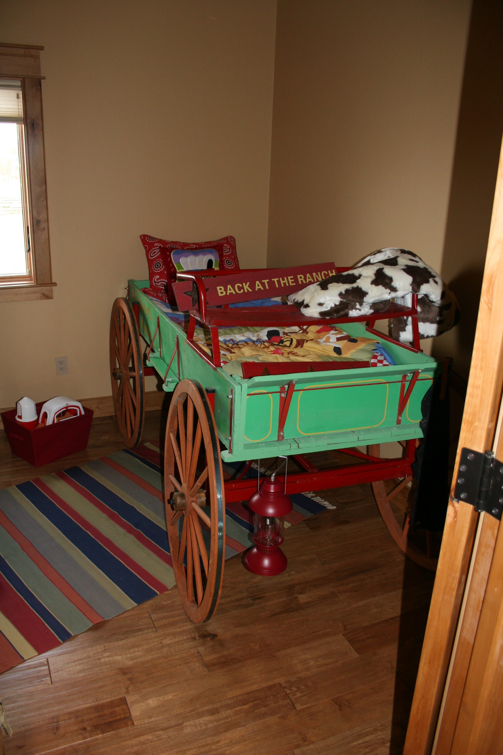 Child's bedroom. Bed made from ranch wagon